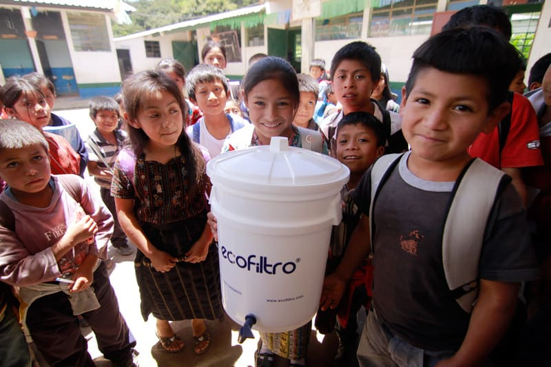 Kids With Ecofiltro Sustainable Water Filter